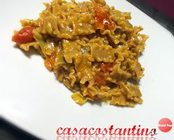 Margherita corta integrale risottata con pomodorini e cuori di carciofini